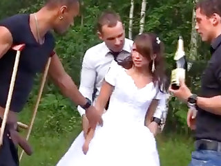 Russian copulate enjoys an interracial gang-bang outdoors