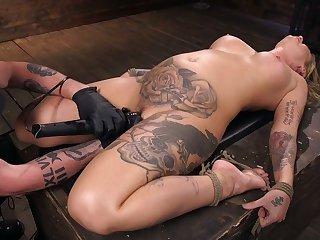 Tattooed porn model Kleio Valentien gets punished in the sinister BDSM room
