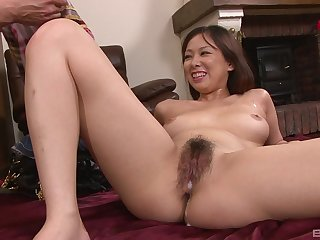 Asian beauty soaks her flimsy cunt in warm sperm