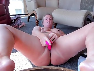 curvy milf with clamped nipples toys and cums enduring
