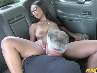 Raven beauty likes sperm on her tits during a ride with the cab