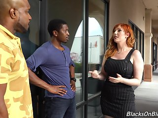 Lone wife with handsomeness curves takes on two black cocks in a hot triad
