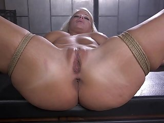 Denuded and bound blonde is fucked in sundry ways wide of her dexterous