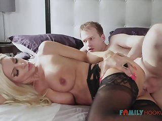 Sizzling blnde COUGAR is wearing softcore, dark-hued stocking while having fuck-a-thon with their way spouse's pal with