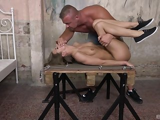 Muscular bloke fucks slave girl and comes on her cunt